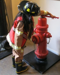 fire hydrant, fire fighter girl, girl helmet boots, putting out fires